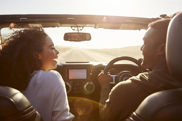 happy couple driving laughing